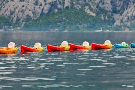 Row of kayaks in the sea