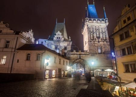 illuminated entrance to Hradcany old town at night, Prague