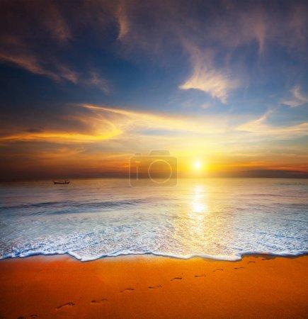 Bright colourful sunset and calm sea.