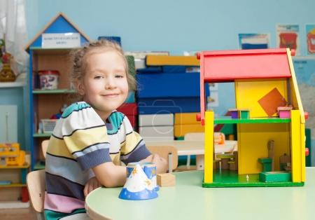 Photo for Child in kindergarten. Kids in nursery school. Girl playing at infant school. Game - Royalty Free Image