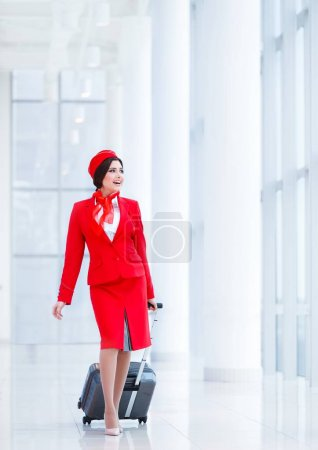 Smiling stewardess indoors
