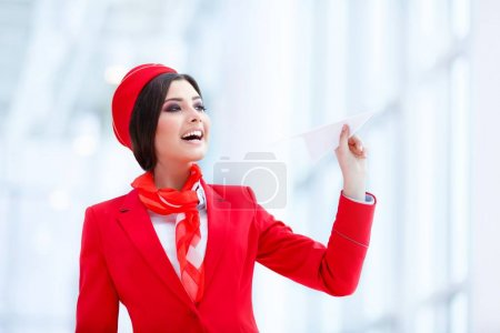 Young stewardess indoors