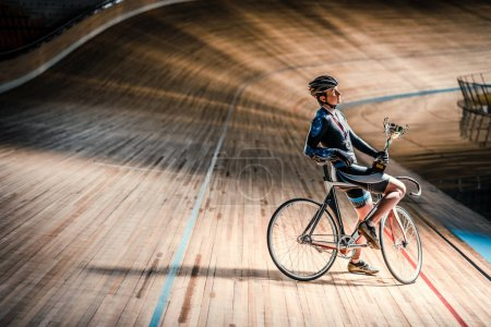 Athlete with a bicycle