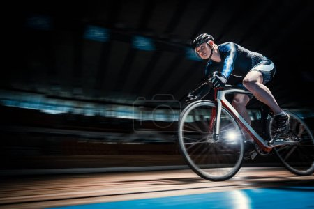Photo for Racing cyclist on velodrome - Royalty Free Image