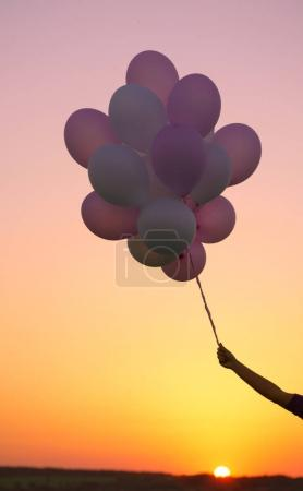 Female hand with balloons