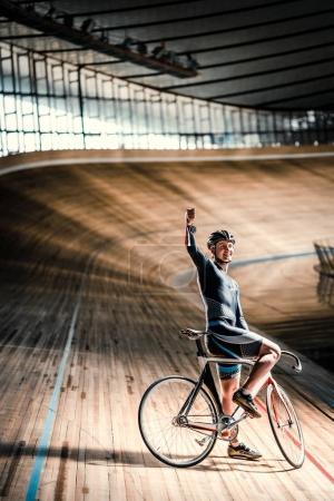 Happy sportsman on a velodrome