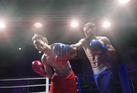 Fighting men indoors