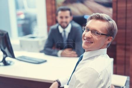 Smiling businessman indoors
