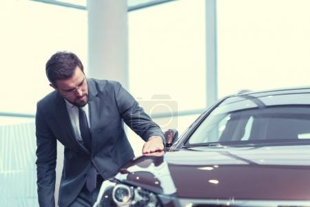Businessman with a car