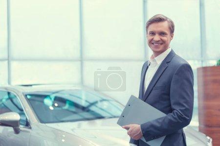 Smiling businessman indoors