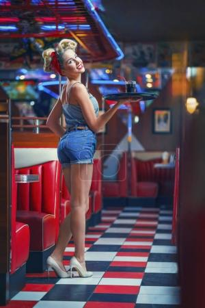 Photo for Pin-up girl in retro cafe - Royalty Free Image