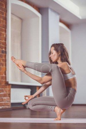 Young girl practicing yoga