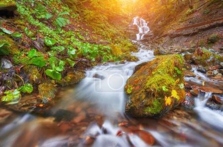 Beautiful waterfall at mountain river