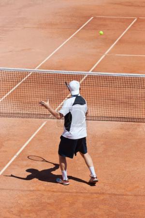 A tennis player strikes the ball