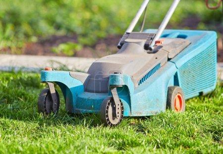 Photo for Lawn mower cutting green grass in backyard,Garden service,grass cutter cutting green lawns. - Royalty Free Image