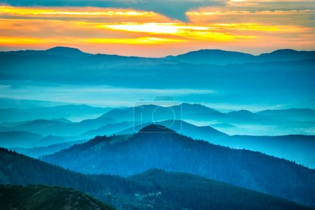 Photo for Sunset in the mountains. Dramatic colorful clouds over blue hills - Royalty Free Image
