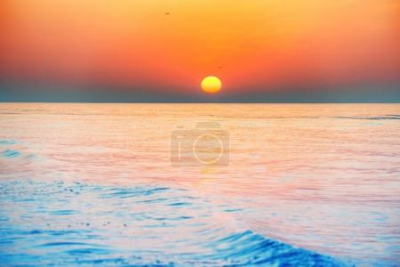 Photo for Sunset or sunrise over sea with sun on beautiful dramatic sky - Royalty Free Image