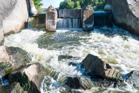Flowing river water near dam
