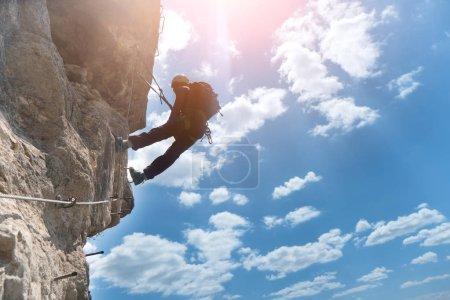 Silhouette of via ferrata climber