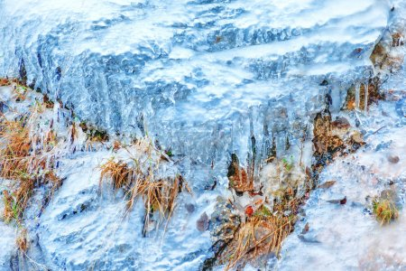 Ice texture on rock. Abstract winter background