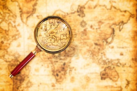 Old map with magnifying glass. Vintage travel background