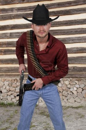Photo pour Homme beau Cow-Boy avec six canons de tireur - image libre de droit
