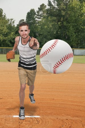 Photo for Man baseball pitcher getting ready to throw a ball in a game - Royalty Free Image