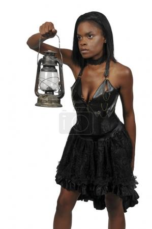 Photo for Woman looking with an old fashoned lantern - Royalty Free Image