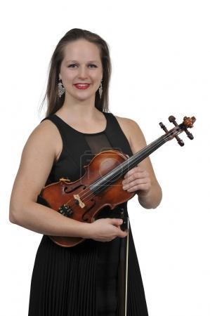 Photo pour Belle jeune femme tenant un instrument classique de violon - image libre de droit