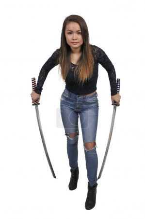 Photo for Young woman with a samurai bushido katana sword - Royalty Free Image