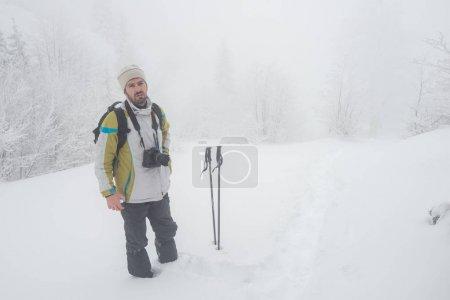 Trekking adventure into mountain during winter snow