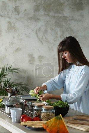 Girl cooks salad