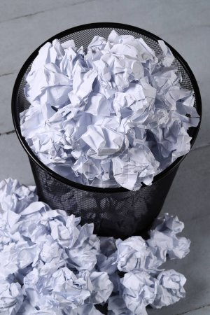 Creased paper in a trash can