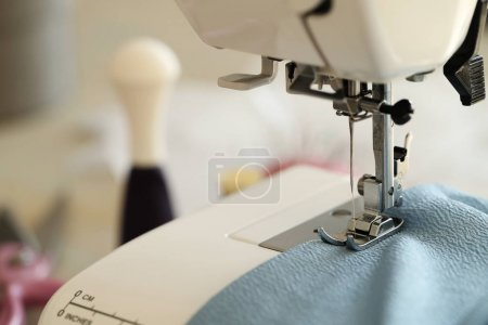 Sewing machine and blue cloth