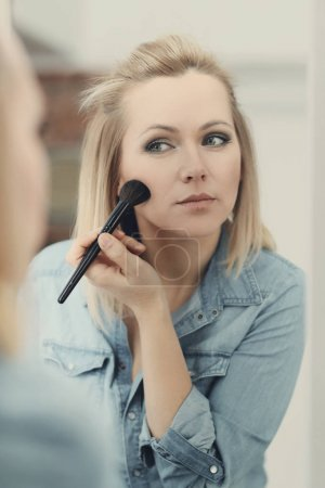 beautiful young woman with a brush