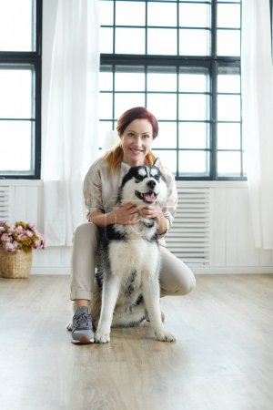 Woman with husky at home