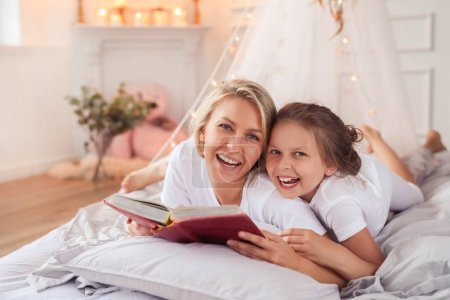 mother with little daughter in bed