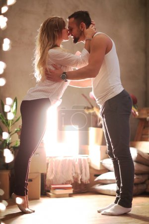 beautiful love couple posing at home, cozy atmosphere