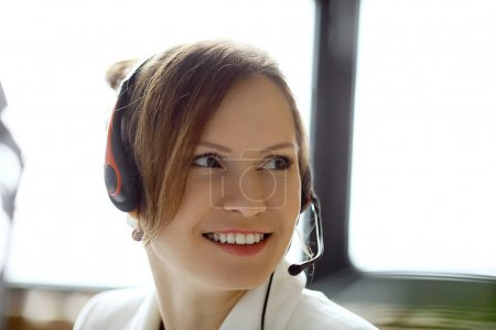 young woman working at call center as dispatcher