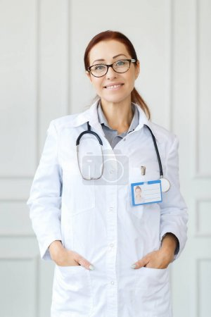 hospital and medicine concept, portrait of female doctor with stethoscope