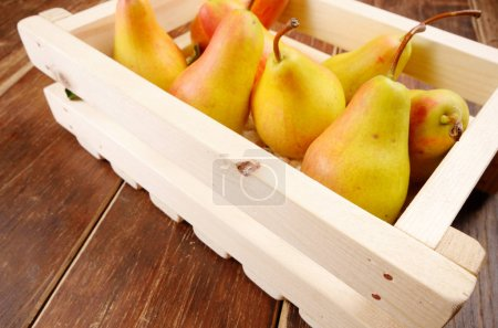 Wooden crate with pears