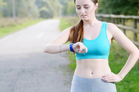 Woman using fitness bracelet