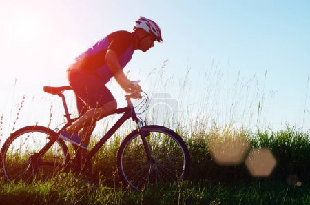 Male cyclist driving outdoors