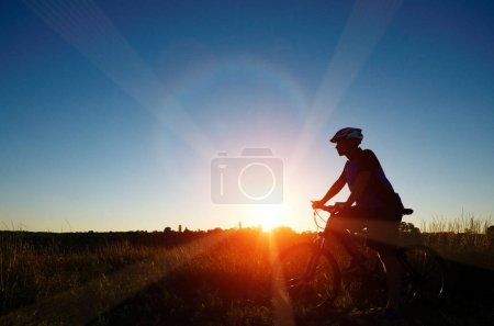 cyclist silhouette having rest