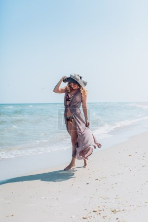 woman on the sand on the seashore