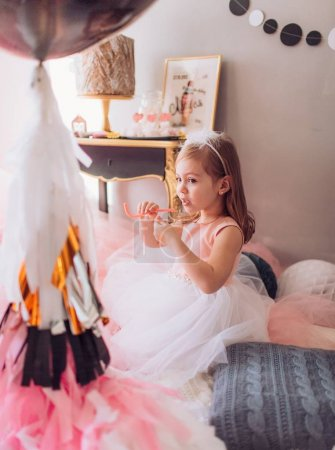 little girl  in room at Birthday party.