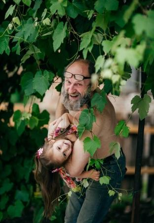 cute little happy girl  with grandfather