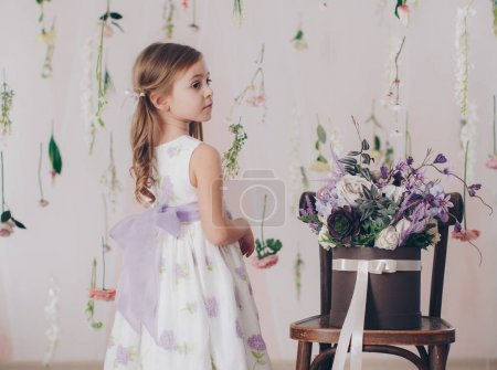 Photo for Cute little girl in dress at home, happy childhood concept - Royalty Free Image