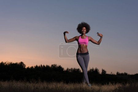 black woman is doing stretching exercise relaxing and warm up