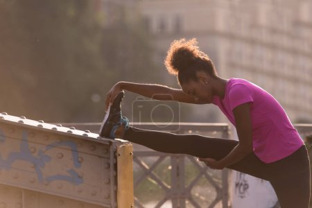 African American woman doing warming up and stretching